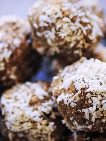 a close up of a mound of coconut bliss balls