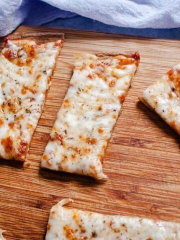 quinoa pizza crust on cutting board
