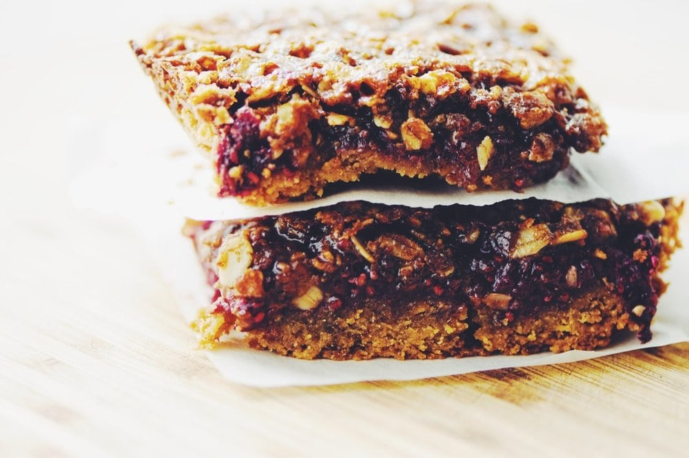 These Gluten-Free Double Berry Chia Seed Jam Crumble Bars make for one healthy and delicious breakfast, snack or dessert! #glutenfree #baking #bars #crumble #crumblebars #chiaseedjam #berries #refinedsugarfree #dessert #breakfast