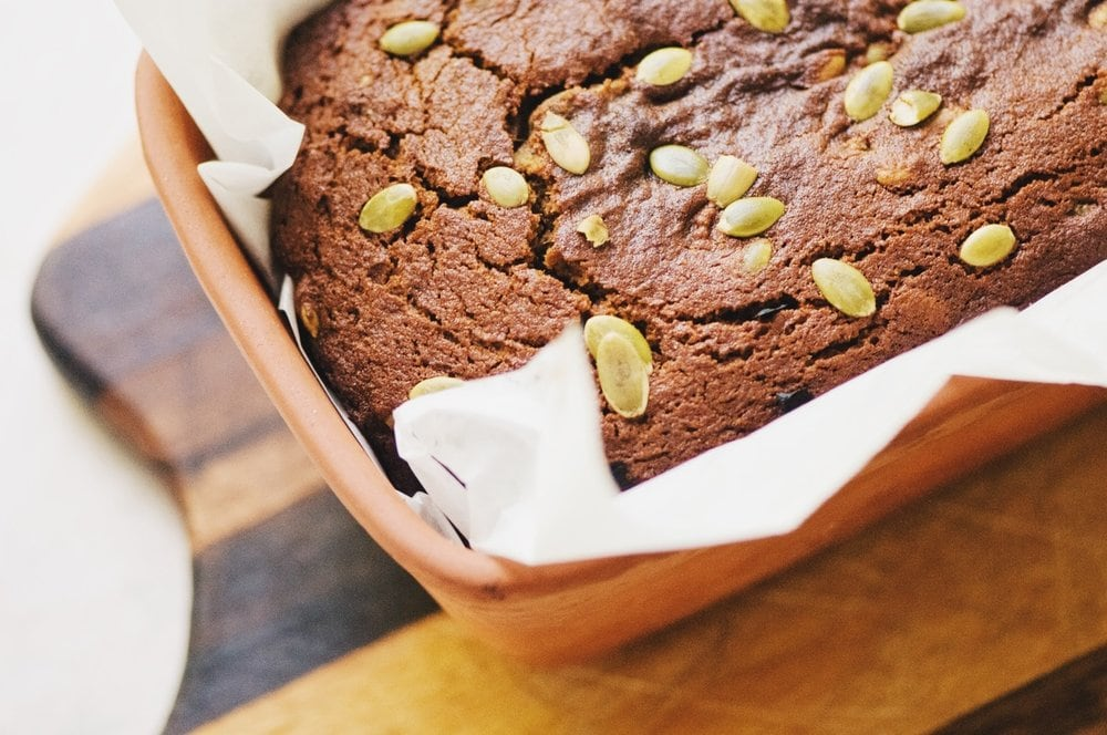 This Gluten-Free Sweet and Spicy Pumpkin Seed Bread is AMAZING! It has a bit of spice, a bit of sweetness, a luscious texture, slices beautifully, stores beautifully and makes a wonderful gluten-free autumn delight! #glutenfreepumpkinbread #pumpkinseedbread #sweetandspicy #autumn #pumpkinbread #glutenfree #pepitas #halloween #baking