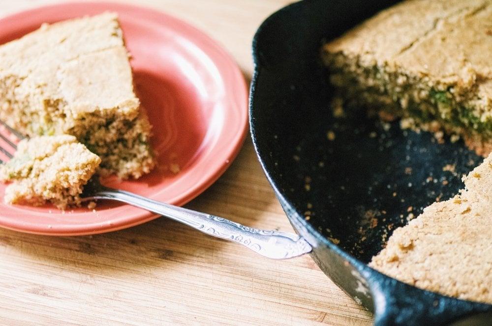 Subtly sweet gluten free buckwheat cornbread pairs beautifully with a savory swirl of basil pesto! Easy and delicious! #glutenfreecornbread #buckwheatflour #buckwheatbread #pestobread