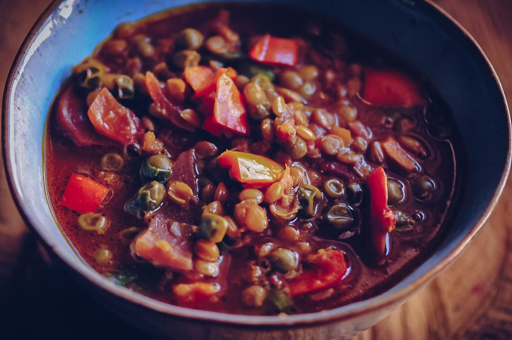 A hearty and nourishing gluten-free & vegan soup chock-full of lentils, beets, peas, bell peppers, garlic, onion, and mixed greens! Throw in the perfect blend of delicious spices and you have one healthy, filling, delicious, easy, and comforting meal ready for a Winter's eve. #beetsoup #wintersoup #lentilsoup #peasoup #comfortfood #glutenfreevegan