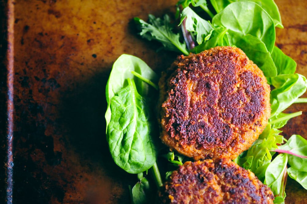 Healthy, easy, and delicious BBQ Chickpea Walnut Burgers. These hearty and filling vegan and gluten-free burgers can be pan-fried or grilled; and pack a most delightful flavorful punch! #veggieburgers #veganbbq #chickpeaburgers #walnutburgers #veganburgers #veganbbqburgers