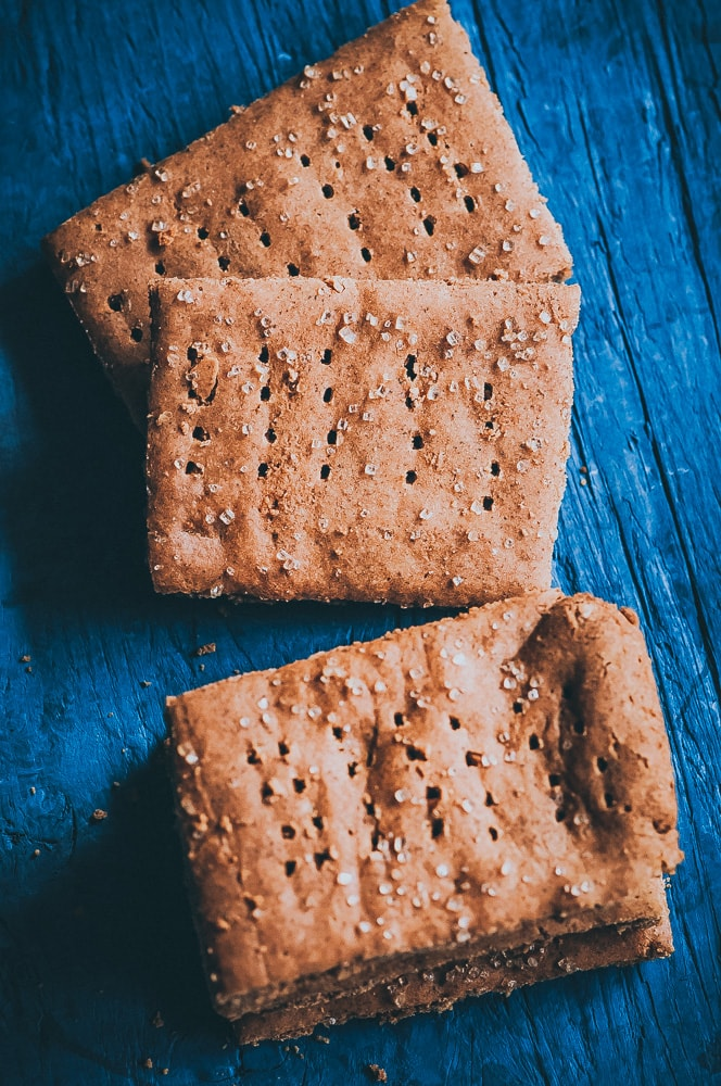 Easy, healthy, and DELICIOUS Gluten-Free Graham Crackers that are also vegan, dairy-free, egg free, soy-free, nut-free and refined sugar-free. This healthy graham cracker recipe is super EASY and certain to please kids and adults alike! #grahamcrackers #glutenfreegrahamcrackers #vegangrahamcrackers #sugarfreegrahamcrackers #glutenfreecheesecake