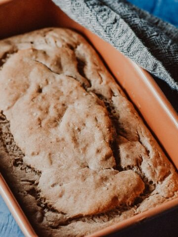 banana bread in a copper loaf pan