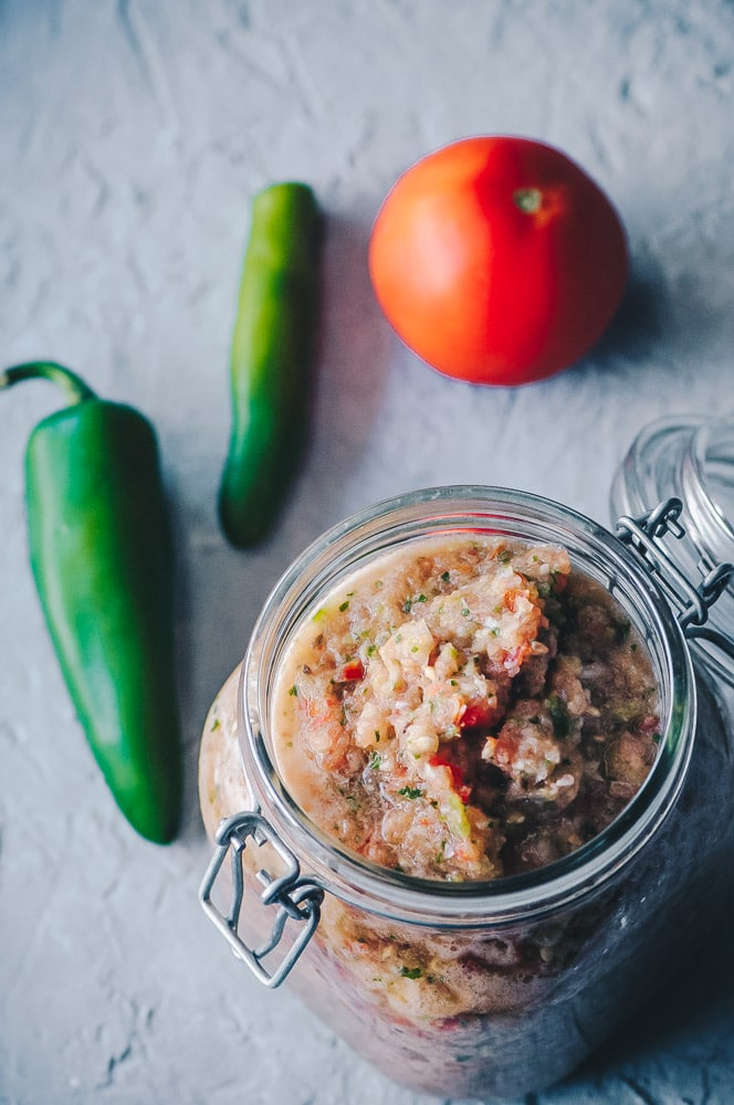 This fresh, easy, homemade salsa recipe is filled with simple & healthy ingredients and packed with flavor for the absolute best delicious garden salsa you could ever make! Most akin to a fresh restaurant style salsa, this vegan salsa is slightly spicy, salty and sweet all rolled into one! #freshsalsarecipe #gardensalsa #mexicansalsa #easysalsa #spicysalsa