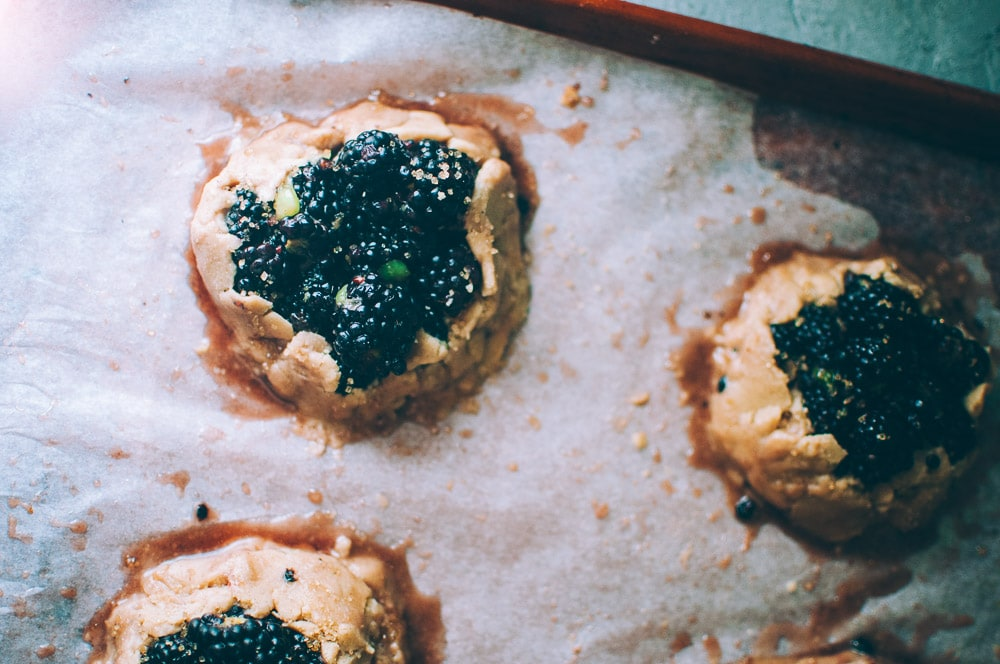 How-to make Mini Blackberry Kiwi Galettes step by step process shots -  These gluten-free vegan mini rustic pies are filled with juicy blackberries and tart kiwi for a fun twist! Easy, healthy, and delicious galettes are at your fingertips! #galette #galettes #minipies #rusticepies #kiwi #blackberries #glutenfreepie #veganpie #kiwipie