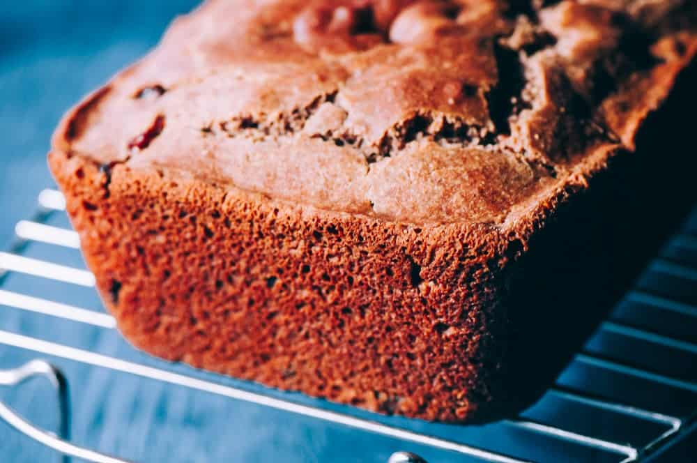 a loaf of gluten free cinnamon bread on a cooling rack