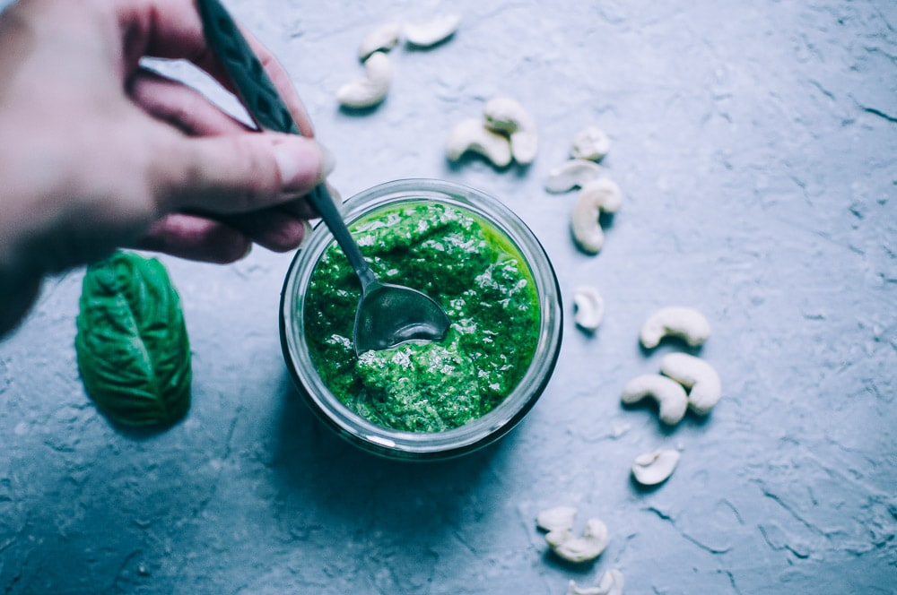 Easy Vegan Cashew Pesto Recipe -  This Vegan Basil Cashew Pesto recipe could not be tastier! Made with just a handful of simple, healthy ingredients, this creamy vegan pesto makes a vibrant accompaniment to variety of foods and dishes! #veganpesto #veganpestorecipe #easyveganpesto #cashewpesto #basilcashewpesto #vegancashewpesto