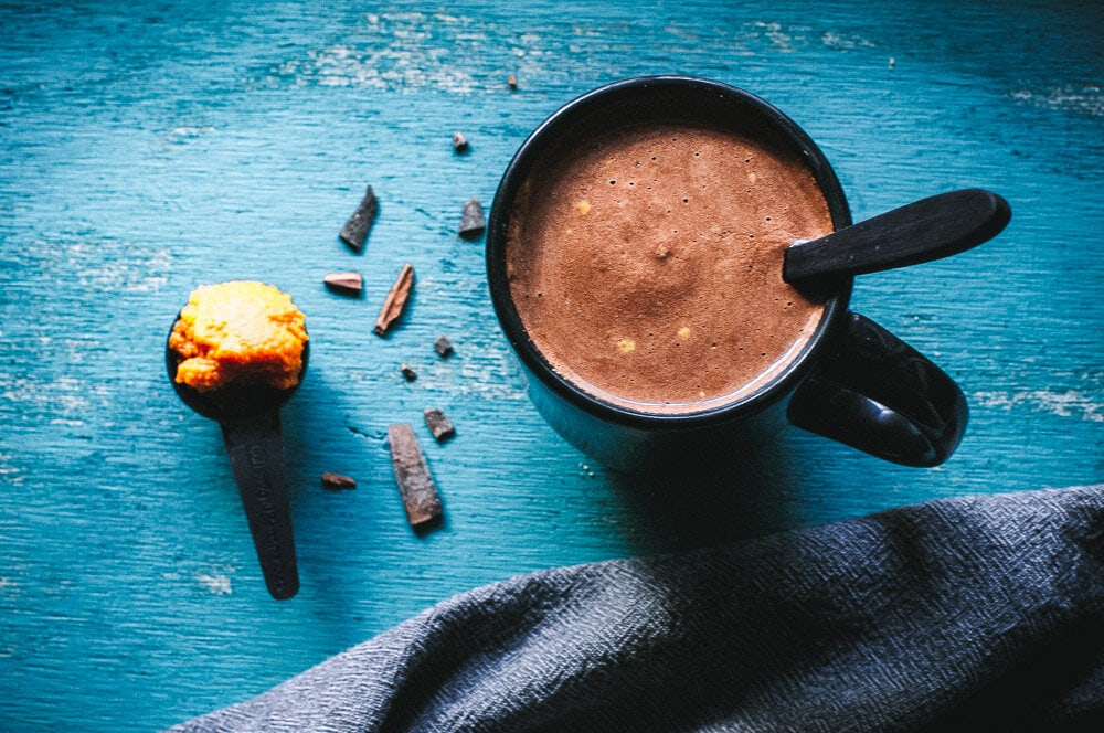 Healthy Pumpkin Hot Chocolate Recipe -  This super creamy and delicious Healthy Hot Chocolate Recipe with Pumpkin is like pumpkin pie in a cup! This autumn beverage made with cacao powder, plant-based milk, pumpkin puree and a dash of warming spices is a nutritious way to get your pumpkin fix sans guilt. Vegan, dairy-free, soy-free, gluten-free + refined sugar-free! #healthyhotchocolate healthy hot chocolate #pumpkinhotchocolate pumpkin hot chocolate recipe hot cacao #hotcacao