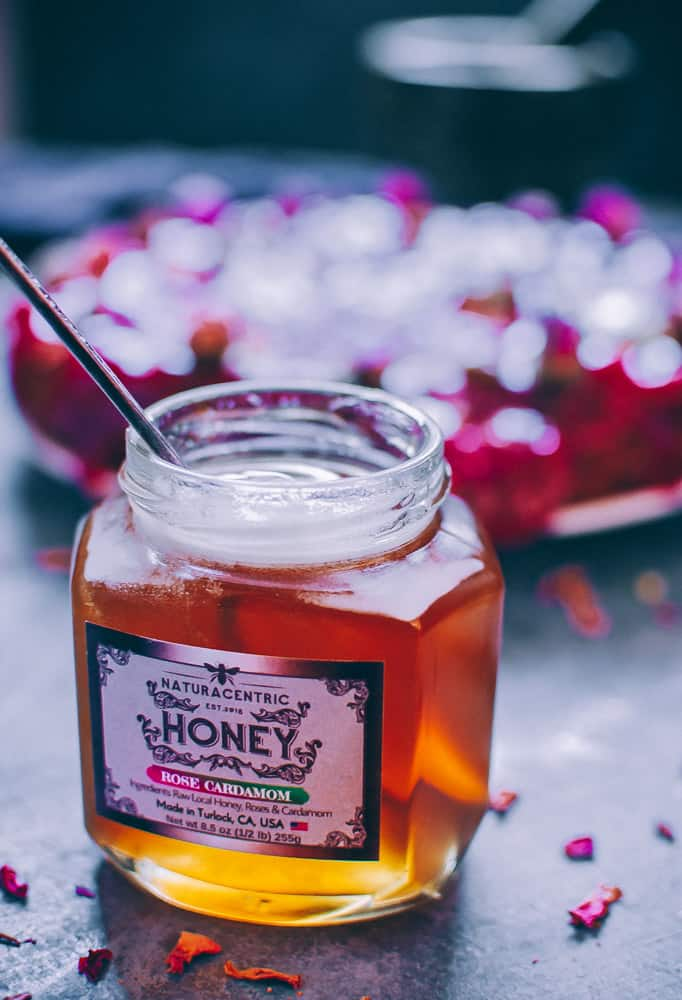 an open jar of naturacentric rose cardamom honey