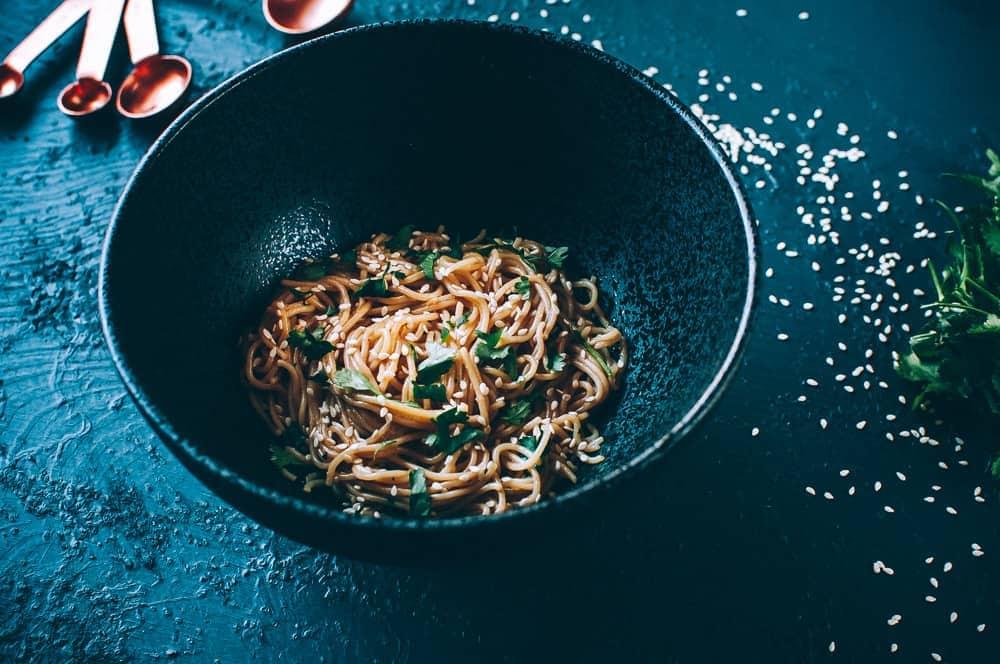 black bowl of sesame noodles