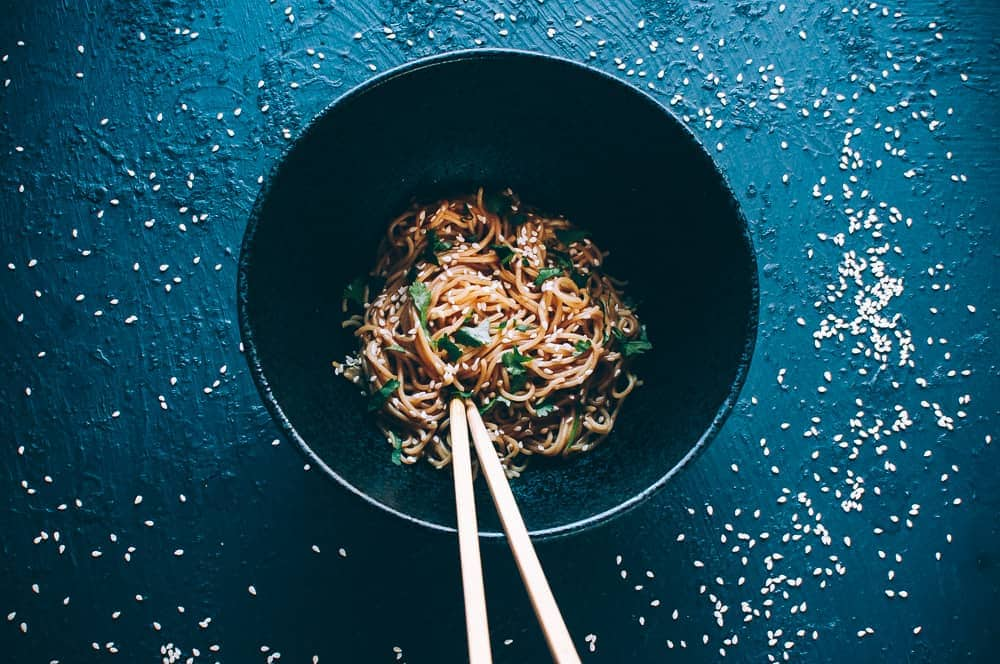 black bowl chopsticks sesame noodles