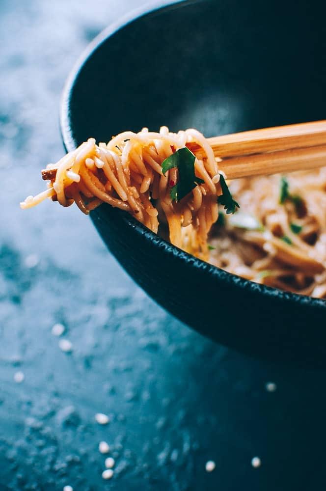 close up ramen noodle wrapped chopsticks