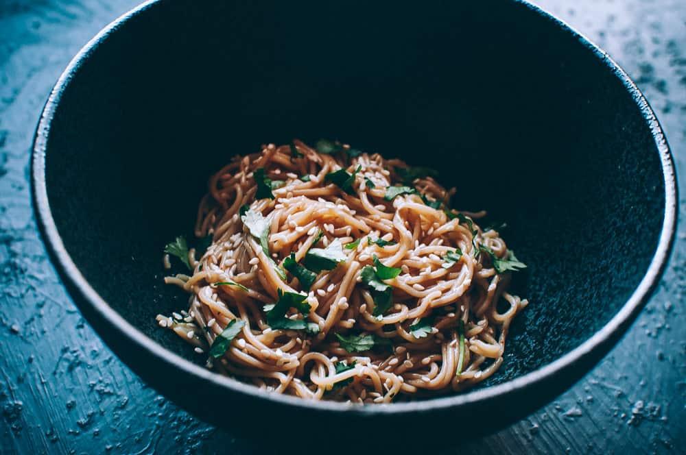 a black bowl of noodles