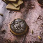 moon milk fudge recipe in a moon sun silicone mold on wooden backdrop