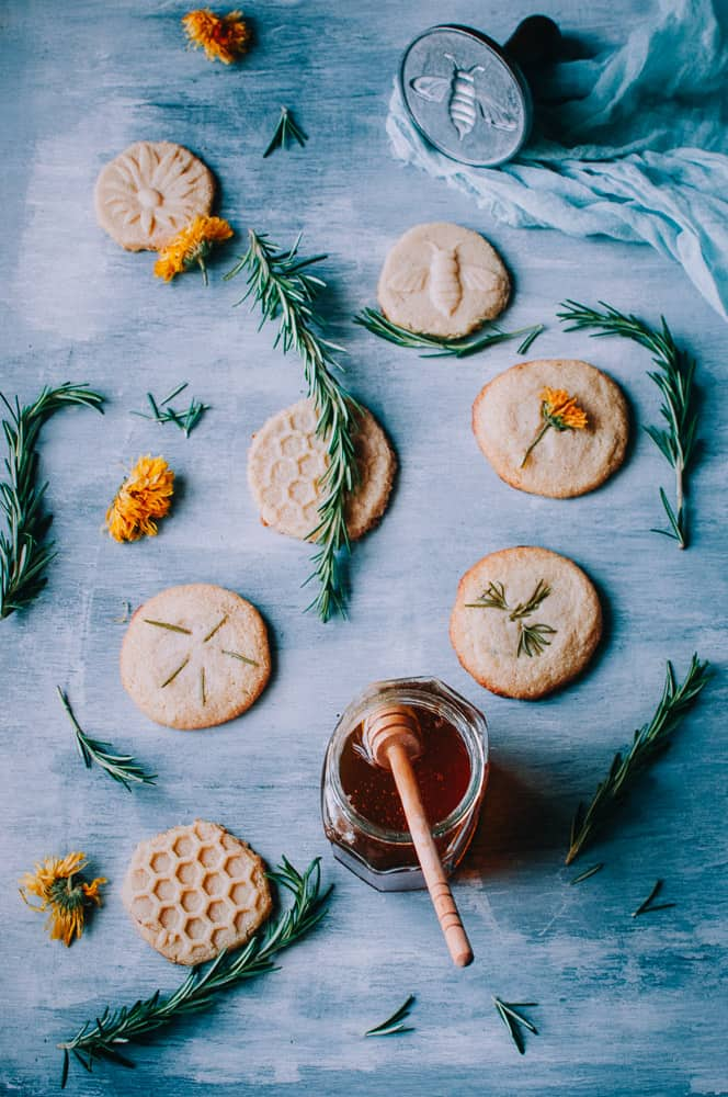 flatlay light blue wooden backdrop shortbread cookies honey and nordic ware cookie stamps