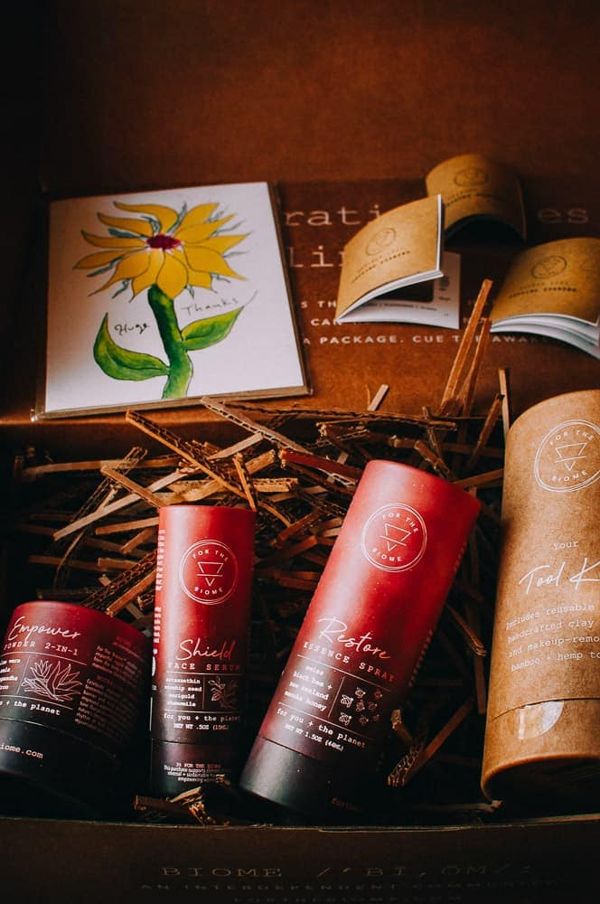 a cardboard box opened to reveal for the biome skincare products