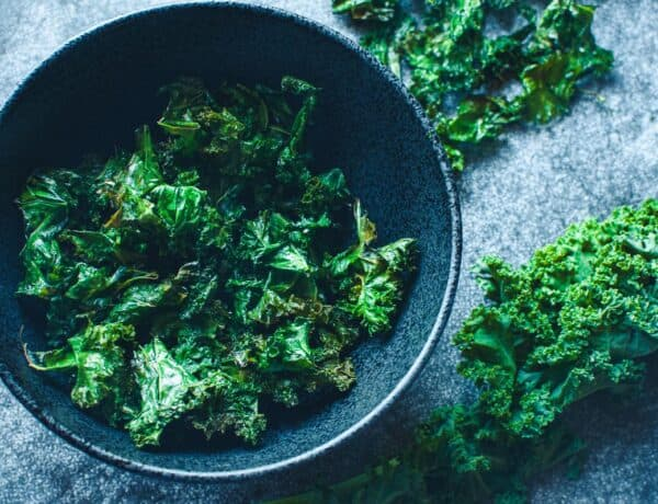 a black bowl filled with kale chips