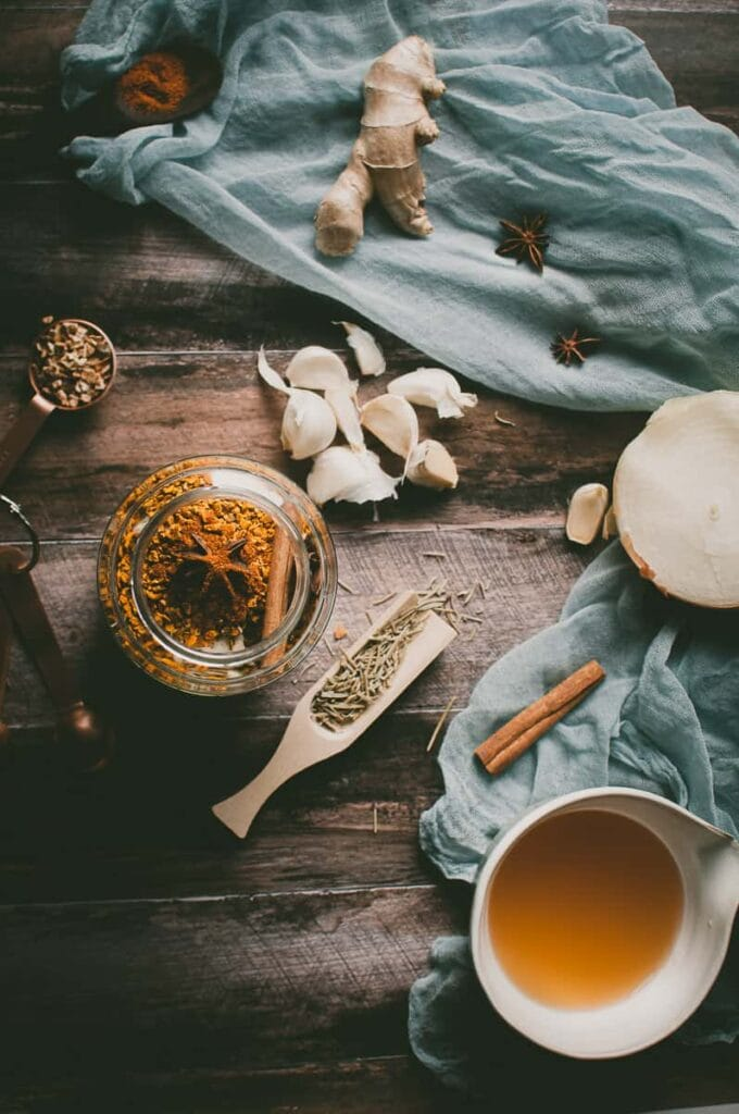 a styled flatlay of fire cider ingredients on a wooden background