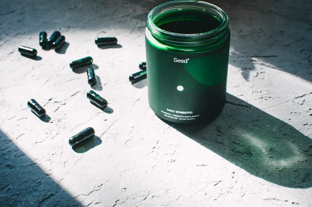 a green jar of seed probiotics