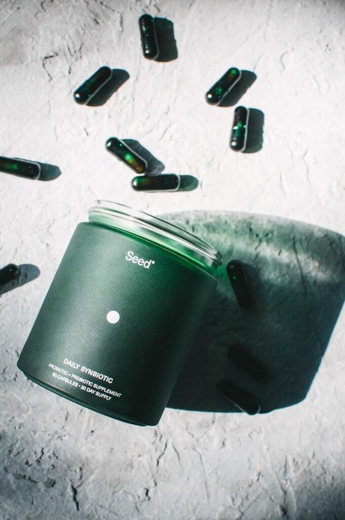 a spilled jar of probiotic capsules