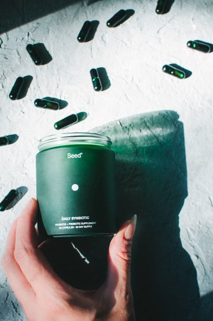 a green seed jar casting its shadow