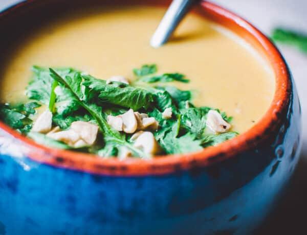 a close up shot of vegan carrot ginger soup