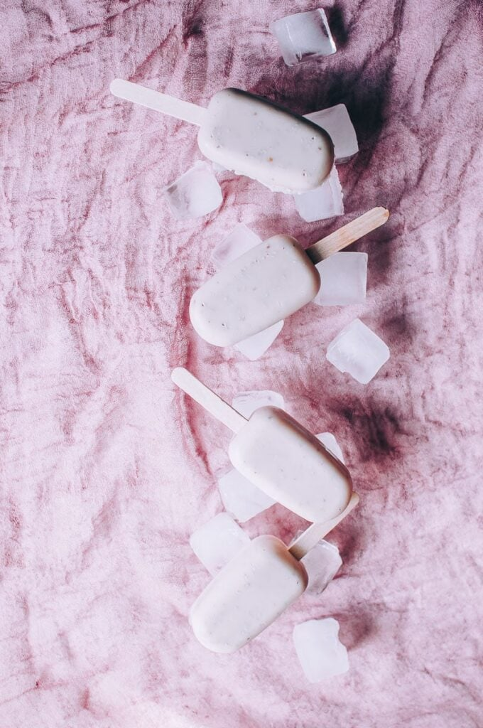 a row of pink popsicles on pink fabric