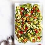 Zucchini Salad with Tomato Basil Feta are a square serving dish
