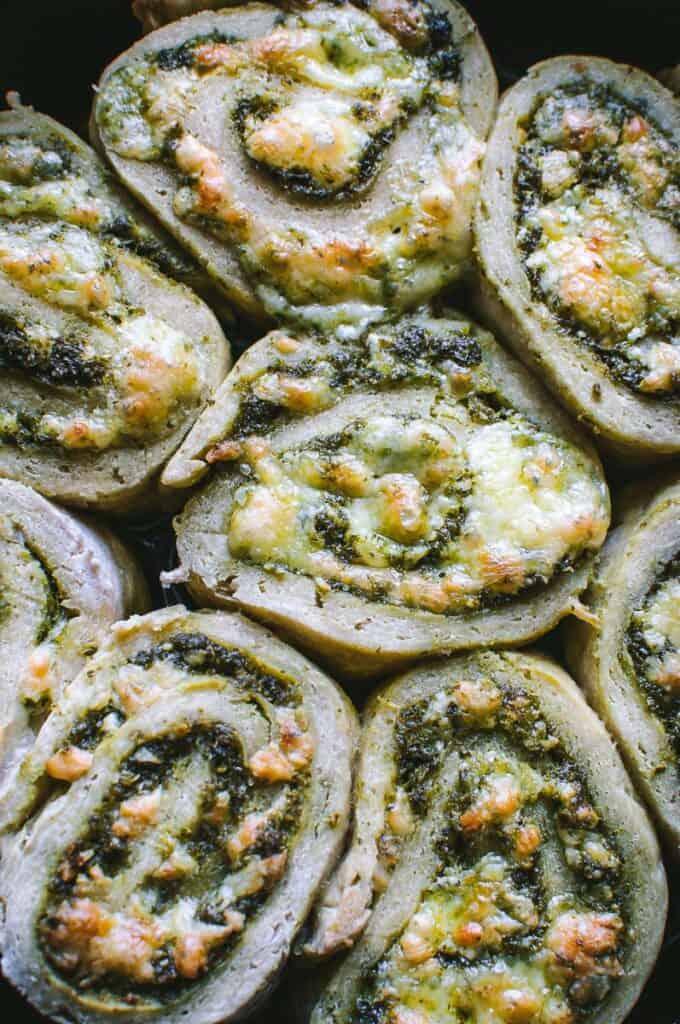 a close up shot of pesto pizza rolls