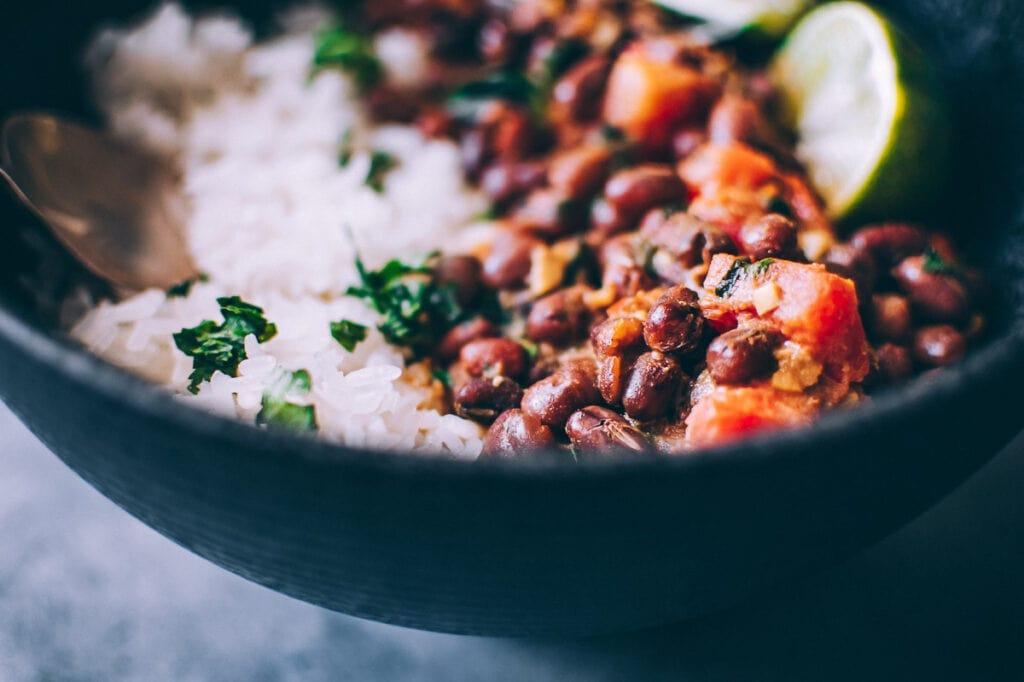 a close up of adzuki beans in black bowl