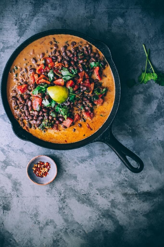 a cast iron skillet filled with adzuki bean coconut curry