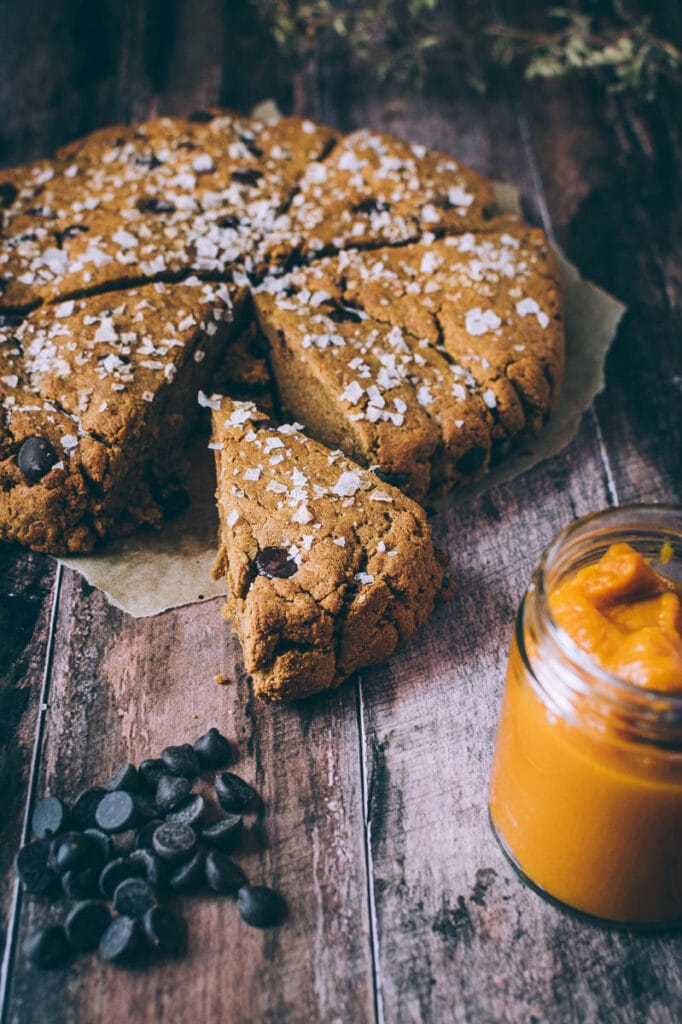 a slice of gluten free pumpkin scones topped with salt and chocolate chips