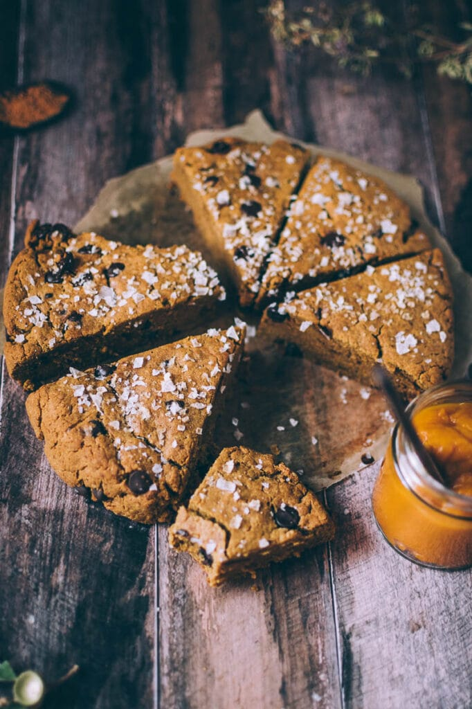 slices of pumpkin scones on a wooden backdrop