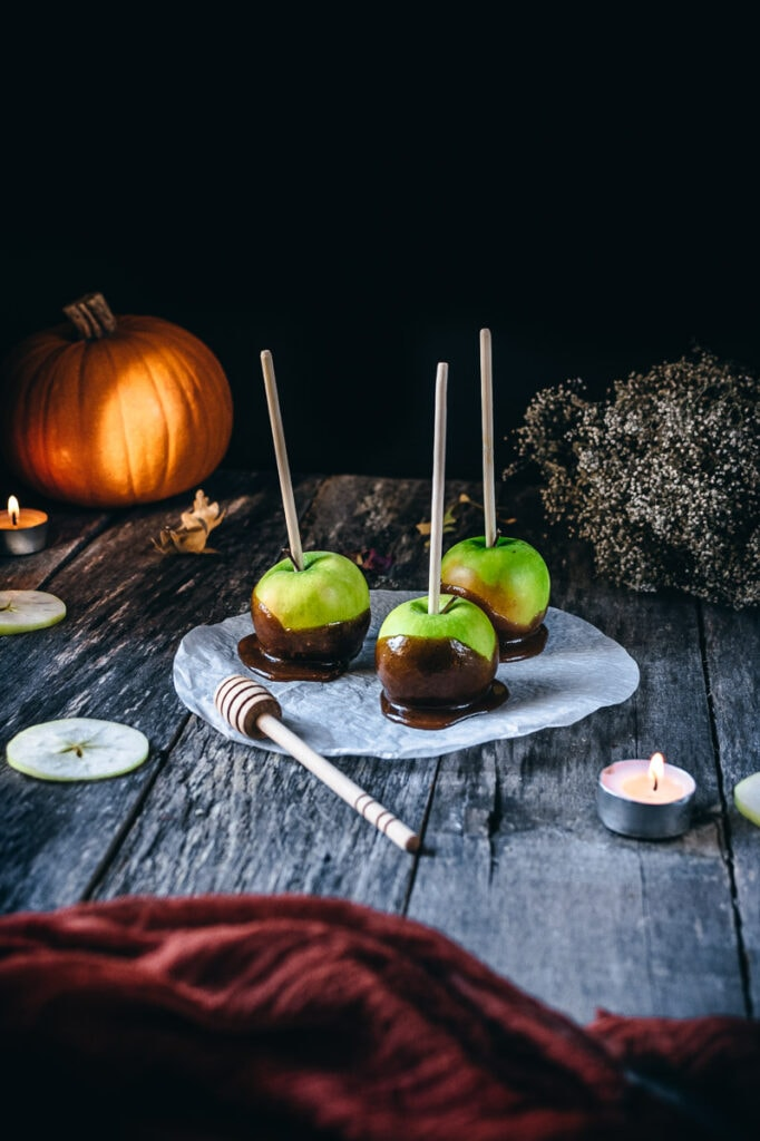 honey candied apples on a wooden backdrop