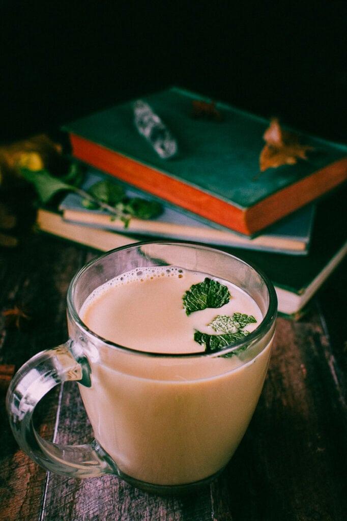 a side shot of a mug of vegan peppermint chai latte