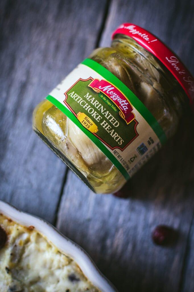 a close up of jar of mezzetta marinated artichoke hearts