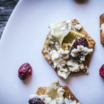 festive artichoke cranberry dip on crackers