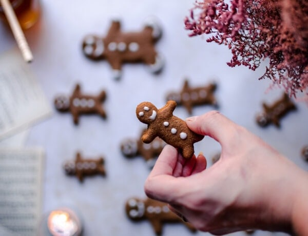 a hand holding a gingerbread man