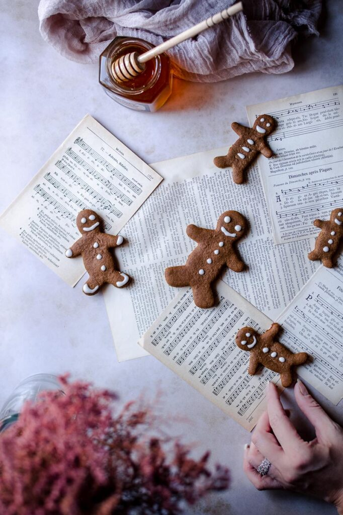music sheets and a hand reaching for a gingerbread man