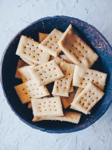sea salt chickpea crackers in a coconut bowl