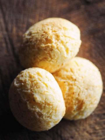 3 pan de yuca rolls on wooden backdrop