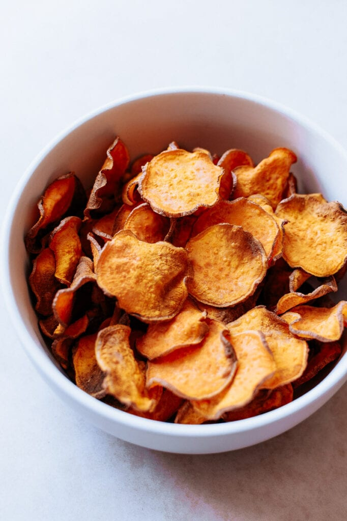 a bowl of healthy sweet potato chips