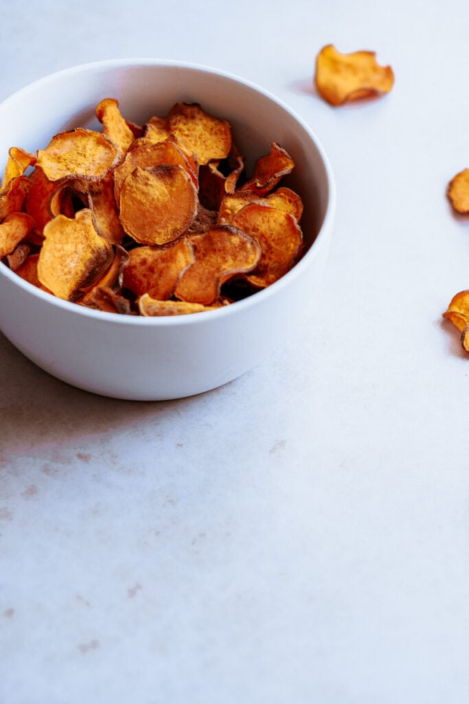a bowl filled with crispy sweet potato chips