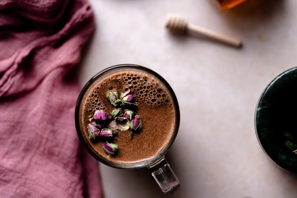 a mug of chocolate rose cardamom monn milk topped with roses