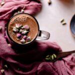 chocolate moon milk with rose cardamom honey in a clear mug