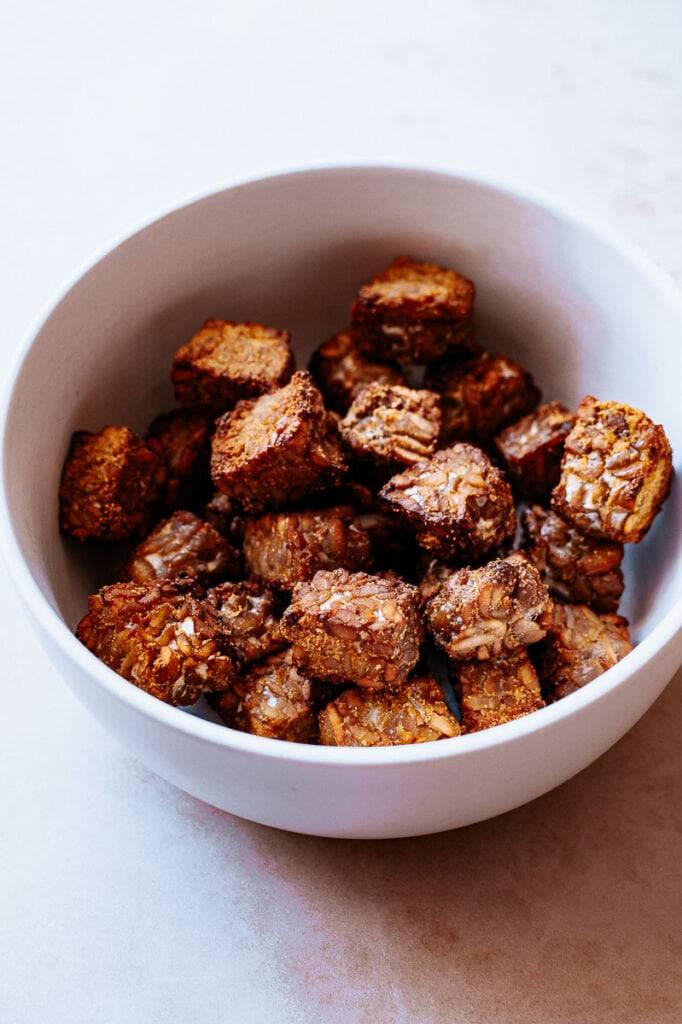 a bowl filled with crispy tempeh