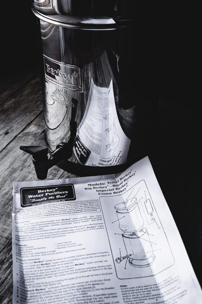 a close up shot of berkey water filter and instruction manual