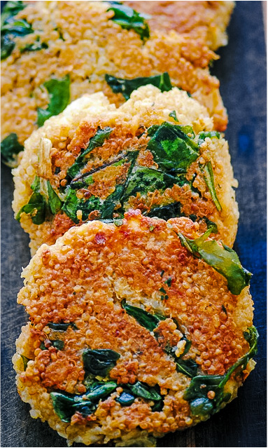 a stack of quinoa patties with greens